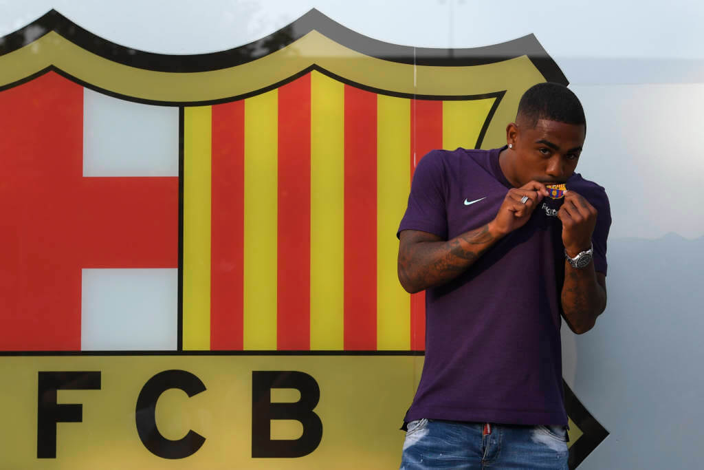 Barcelona's new Brazilian forward Malcom poses at the Camp Nou stadium in Barcelona on July 24, 2018. Spanish champions Barcelona announced they have signed Brazilian winger Malcom from French side Bordeaux on a five-year deal for 41 million euros ($48 million). / AFP PHOTO / LLUIS GENE